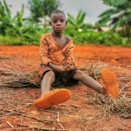 A Refugee Child Is Resting After A Trip Where He Was Loking For The Pieces Of Dry Leaves